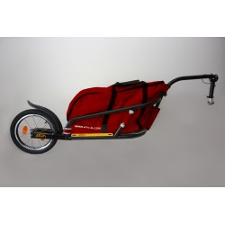 """Black Žeryk 16"""" with red bag and seatpost hitch"""